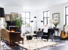 Warm and inviting living room Iconic Serge Mouille Lamps Transcend Design Styles And Eras! Contemporary Floor Lamps, Modern Floor Lamps, Living Room Designs, Living Spaces, Black Fireplace, Cozy Fireplace, Deco Design, Interiores Design, Apartment Living