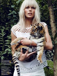 Marie Claire Netherlands Model: Marlijn Hoek Photographer: Carmen Kemmink Styled by: Marjolein Mos EDITORIAL WHITE IN THE WILD ALL WHITE SPRING SUMMER LOOKS BLEACH BLONDE HAIR  WHITE DENIM WHITE LATTICE CUT OUT TOP BABY TIGER