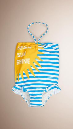 A halter-neck swimsuit in striped stretch fabric with a bold Hello Sunshine graphic, from Burberry. Design details include frill detailing at leg and a clip-fastening to the neck strap.
