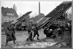 Soviet soldiers loading Katyusha multiple barreled rockets in preparation for the final assault on Berlin