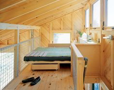 The interior is clad exclusively in white pine, the diagonal orientation adding visual interest to the neutral palette. Alex sourced utilitarian features like cattle fencing and plumbing pipe for the loft sleeping area.