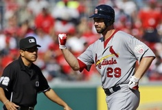 Chris Carpenter celebrates after hitting a double in the fifth inning. Playoffs