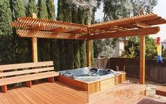 Corner trellis and deck around hottub