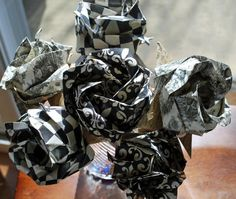 6 origami roses in shades of black and white. The paper used to make the flowers are patterned with fleur-de-lis & toile