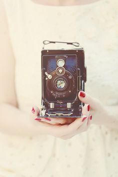 The girl with her old camera.