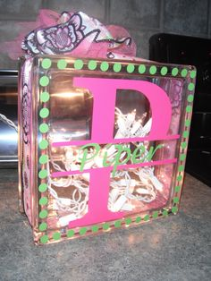 Glass block with string lights inside (a hole is drilled in the bottom for the cord) and decorated with a silhouette. Cute nightlight!