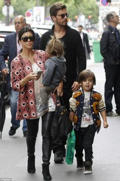 Family time: The couple Kourtney Kardashian and Scott Disick and their young brood Mason Dash Disick  Penelope Disick took some time to enjoy Paris on Tuesday. They visited a Ralph Lauren and Sonia Rykiel store