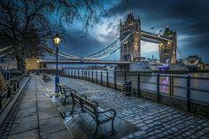 Romantic night walk by the Tower Bridge, London UK