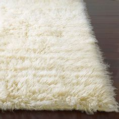 cream flokati rug $186... can't vacuum these rugs? um, that's a problem...