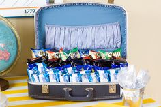 "Serve bags of chips, peanuts, pretzels, popcorn out of a suitcase! Can use it for ""ooh the places you'll go"" Cade seuss party!"