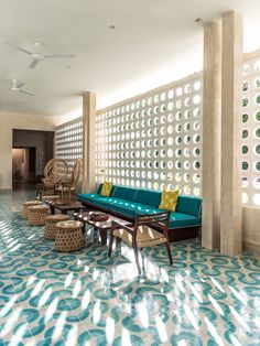 The tropical retro mid century hotel lounge at the Tiki Tiki Tulum. www.hoteltikitiki... Tile floors, lattice, Architecture and Interior Design by Arturo Zavala Haag