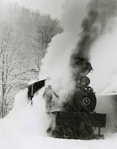 Fireman firing the boiler on a steam locomotive, West Virginia.  Awesome pic! I love riding on the old steam trains. Rode one years ago in PA and then locally in Salisbury Train Museum