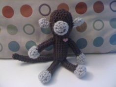 My crocheted monkey. I added a little glitter heart button to make him alive (like the Tin Man in the Wizard of Oz)