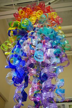 Students Inspired by Chihuly Chihuly-inspired sculpture by Tonawanda Middle School students. Plastic bottles painted with acrylic.Chihuly-inspired sculpture by Tonawanda Middle School students. Plastic bottles painted with acrylic. Water Bottle Crafts, Plastic Bottle Art, Plastic Bottle Flowers, Plastic Art, Recycle Plastic Bottles, Water Bottle Art, Plastic Recycling, Plastic Design, Plastic Spoons