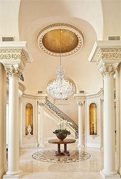 Exquisite foyer is enhanced with faux gilding,dramatic crystal chandelier,elaborate dome ceiling. Soaring 20 foot ceiling,Corinthian columns,vaulted arches with faux bronze dore decoration. Marble inlay imported from Iran is the centerpiece of room. Classic Decor, Classic Interior, Luxury Interior, Interior Architecture, Interior And Exterior, Interior Design, Interior Columns, Beautiful Interiors, Beautiful Homes