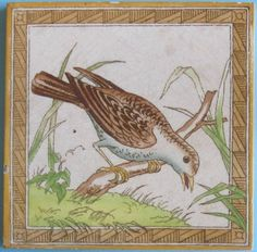 Rare, bird study tile transfer-printed in brown on an ivory clay body with a wonderful aesthetic design border, hand-painted in eight colors, from Minton Hollins, c. 1880. I think the grasses growing out...