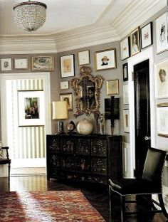 LAYERS: If done in a composed way, layering can be quite modern, even if the items are specifically antique. Elements of crystal, black lacquer, gilt and geometric patterns combine to create one knock-out foyer! (This is Kate Spade's home, by Steven Sclaroff, from The World of Interiors Magazine)