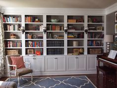 Love how the sconces built into the bookcase, and the dark color of the back of the bookcase. || COTTAGE AND VINE: DIY Built-ins | Reader Spotlight