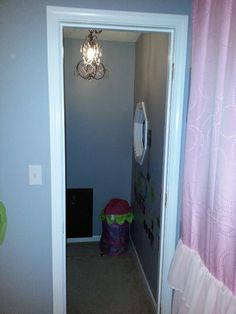 Closet with secret passage and a little girl's own mural