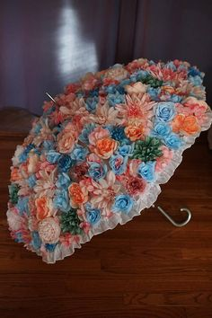 Add a unique and beautiful accessory to your wedding photos with the Wedding Umbrella! The Wedding Umbrella is a custom creation made just for you on your special day. I will work with you to choose the colors and flowers that coordinate best with your style to create a unique and