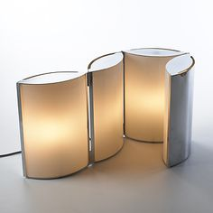 Lot 439: Jean-Pierre Vitrac. table lamp. c. 1970, chrome-plated steel, glass. 12 w x 11½ h in. result: $12,000. estimate: $10,000–15,000. An adjustable table lamp that can be folded inward to create a circular form or extended outward for direct lighting.