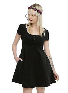 "<p>Black fit and flare corduroy dress with two pockets and snap button detail.</p>  <ul> <li>33"" long from shoulder</li> <li>98% cotton; 2% spandex</li> <li>Wash cold; dry low</li> <li>Imported</li> </ul>"