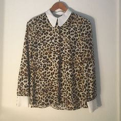 Zara leopard print blouse Pretty leopard blouse with with trimming and covered button details. Fits XS/s love! Zara Tops Button Down Shirts