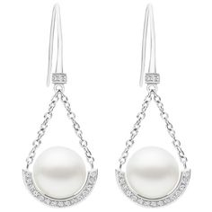 Kailis Australian South Sea pearls. A french hook style drop earring with articulated chain suspended from a diamond accented hook, this medium-long earring transitions seamlessly from glamorous day wear to elegant evening. View our collection of pearl and antique jewellery at www.rutherford.com.au