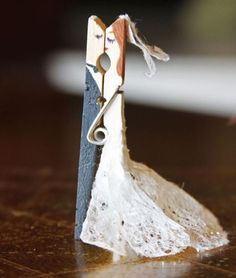 Clothespin Craft:  Bride & Groom -This would be so cute pinned onto a wedding gift -- or as reception table decor meant to be taken home by guests afterwards.  -LRE