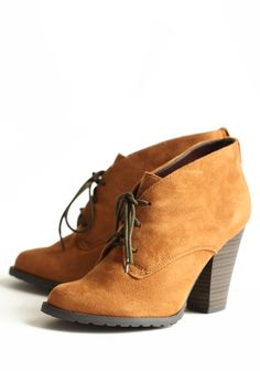 Soho Lace-up Booties In Ginger Snap 39.99 at shopruche.com. Crafted in soft faux suede, these ginger snap colored ankle boots feature a lace-up front and a faux stacked heel. Finished with a grip sole, these adorable boots pair perfectly with any fall or winter ensemble.All man-made materials, Imported,...