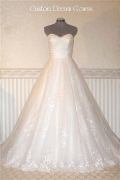 Breathtaking Sequin and Lace Applique on Tulle Wedding Ball Gown with Sweetheart Neckline, Spaghetti Straps, Fitted Bodice with Grosgrain Belt Decorated with Handmade Flowers and Lace Motif, Full Ball Gown A-Line Skirt, Chapel Train, Back Covered Button Hidden Zipper Close. #CustomDreamGowns #Jayla #customweddingdress #customweddinggown #customdress #lace #tulle #ballgown #beautifuldress #dreamwedding #sparklydress #sweetheart #chapeltrain #gorgeouswedding #2014weddingdress #bestweddinggown