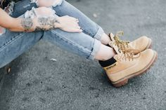 Le Happy wearing ripped jeans and classic Caterpillar Colorado boots