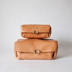 travel bags by Hoi Bo and available at Mjolk. The bags are made from one piece of molded leather and entirely constructed by hand – there is no machine work used on the leather case.