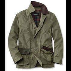 The Gleason Jacket Orvis Men's Cut from lightweight cotton blend, and lined for three-season wear, it sports wingshooting-inspired features, including shoulder stitching and functional storage in lieu of a game pocket. Outfitted with dual handwarmer pockets, a pair of roomy bellows pockets, and three interior pockets. Faux-suede collar trim. In light olive. Cotton/polyamide shell. Polyester/cotton body lining. Nylon drip strip and sleeve lining. Washable. Good condition Orvis Jackets & Coats