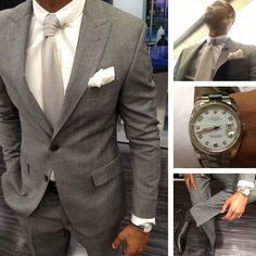 Grey suit, white shirt, light grey tie, black shoes, black polka dot socks, with the silver Rolex watch.