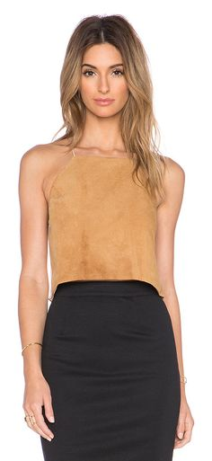 The suede crop top by CAMI NYC. Self: Genuine leatherCombo: Silk blend. Dry clean only. Contrast textured fabric. CAMN-WS14. SUED...