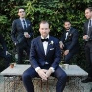 groom ad groomsmen in navy suits