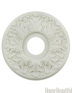 """A ceiling medallion will give presence to a crystal chandelier hanging from a vast, blank ceiling. They're easy to install. Then mix a little plaster into the paint to give it a chalky, timeworn look,"" says Lindsey Bond.  Try: Portfolio 169 White Ceiling Medallion, $27. lowes.com.       - HouseBeautiful.com"