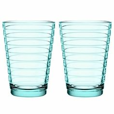 Aalto means wave. The glasses offered here are from the Aino Aalto glass series, designed for the Finnish design manufacturer Iittala in 1932 by designer Aino Aalto, the wife of the architect and designer Alvar Aalto.