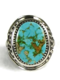 "Natural Royston Turquoise Ring Size 12 by Derrick Gordon. This is a beautifully detailed handmade natural Royston turquoise ring by Navajo artist, Derrick Gordon. Very well known for his expertise in silversmithing, Derrick has set this turquoise gem in a handmade saw tooth bezel and has adorned the sides with his applique and repousse, 13/16"" by 9/16"". The ring is 1 1/16"" at front and center tapering to 1/8"" at the ring shank. Nicely shaped on interior for comfort fit. Beautiful quality."