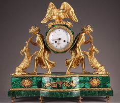 Gilt bronze and malachite mantel clock representing two feminine characters supporting on their back the dial surmounted by a vulture with spread wings. Signed RAINGO, c. Antique Mantle Clock, Mantel Clocks, Antique Clocks, Antique Desk, Antique Watches, Clock Art, Desk Clock, Bronze, Unusual Clocks