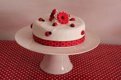 Lady beetle cake, made with chocolate mud cake, fondant and handmade fondant beetles