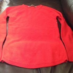 Athleta sweater XXS red Brand new varsity sweater. Athleta red. Zips on each side. Will come in plastic bag bought online. Athleta Sweaters Crew & Scoop Necks