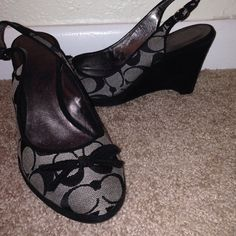 Coach wedges Coach size 8 black and grey wedges. About 3 inches. Wedge has suede on them. Bow on front of shoe. Has adjustable strap on heel. Coach Shoes