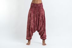 "These magical Low Cut Harem Pants can be converted into a jumpsuit. It's like buying one outfit but getting two. They are great for lazy Sundays, doing yoga, or hula hooping at a music festival. Free international shipping on all orders over $60. Sizing: One size fits most. Measurements: Waist: 24"" to 38"" Hips: up to 44"" Total length: 43"""