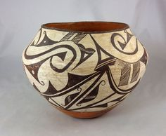 """Sweet child size pottery jar from Acoma Pueblo, circa 1920s, stnads 6 3/4"""" tall and is 8 1/2"""" diameter."""