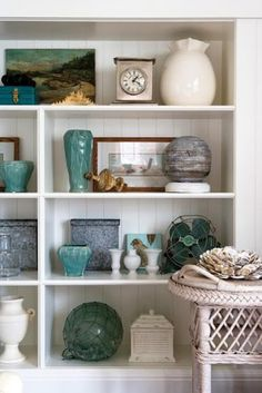bookcase styling: this link has a bunch of pictures of perfectly decorated bookshelves. Love the breadboard.