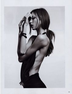 """Anorexic model or just built this way?  Some women are naturally underweight.  This example at least has healthy muscle tone.  Don't be quick to judge.  Many """"skinny"""" women would like to put on a little lean mass.  Many """"skinny"""" women can have just as high of body fat as an overweight person. And for many women - looking like this is NOT a realistic or healthy goal."""