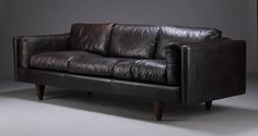 Illum Wikkelso 3 seat V11 series choco brown leather sofa. Fantastic rosewood pyramid feet. 4250GBP