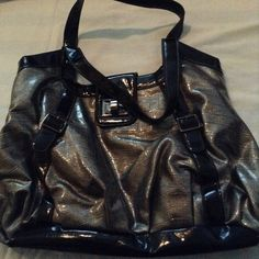 Black and Silver purse Black and silver purse. Has zipper pocket inside.  Bag 15 in length strap 9 inches and bags heigh 11 inches. Size large. Bags Shoulder Bags